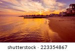 Stock photo the sun sets on the final days of summer over a beach on long island sound in connecticut 223354867
