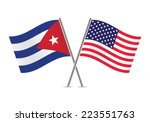 american and cuban flags.... | Shutterstock .eps vector #223551763