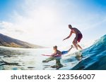 father and son surfing together ... | Shutterstock . vector #223566007