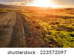 gravel road through a barren... | Shutterstock . vector #223572097