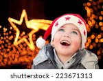 Child With Santa Claus Hat...