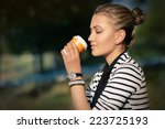 Woman Drinking Hot Beverage...