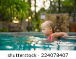 adorable girl swim in pool at... | Shutterstock . vector #224078407