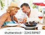 senior couple enjoying meal in... | Shutterstock . vector #224158987