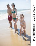 happy family in swimsuit having ... | Shutterstock . vector #224164237