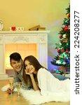 happy couple having drinks by ...   Shutterstock . vector #224208277