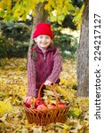 little girl in autumn park with ... | Shutterstock . vector #224217127