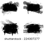 set of four grunge tire track... | Shutterstock .eps vector #224307277