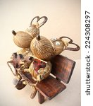 """Small photo of In Love Story """"Cute Buffalo"""" Hand-made of suicide (body), coconut shell (horn and foot), Banana rope, branch tree and afzelia xylocapa seed (nose)"""
