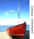 A Boat Moored On The Beach In...
