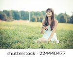 beautiful young woman with... | Shutterstock . vector #224440477