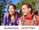 couple eating muesli bar hiking.... | Shutterstock . vector #224577067