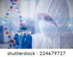 scientist in protective suit... | Shutterstock . vector #224679727