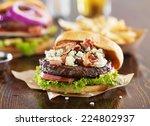 Gourmet Burgers On Wooden Tabl...