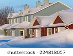 Rowhouses With Piles Of Snow...