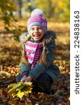 little girl with autumn leaves... | Shutterstock . vector #224838163