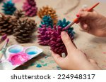 Child Painting Pine Cones As...