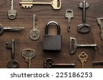 Small photo of check-lock and different keys on wooden background concept
