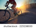 man cycling in the desert with... | Shutterstock . vector #225238033