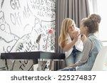 teenage girl putting lipstick...   Shutterstock . vector #225274837