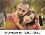 sweet couple in autumn park.... | Shutterstock . vector #225772567
