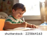little boy write into exercise... | Shutterstock . vector #225864163
