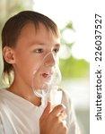 ill boy with inhalator over... | Shutterstock . vector #226037527