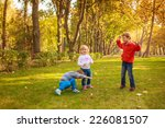 happy kids jumping in the park | Shutterstock . vector #226081507