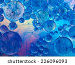Macro Of Oil Drops And Pigment...