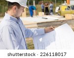 architect standing studying a... | Shutterstock . vector #226118017