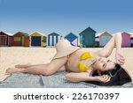 asian woman wearing bikini in...