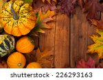 Autumn Pumpkins Surrounded By...