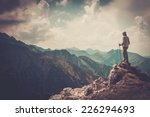 Woman hiker on a top of a mountain