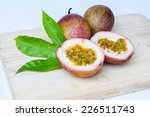 ripe passion fruits on wooden... | Shutterstock . vector #226511743