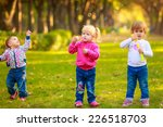 happy kids with soap bubbles in ... | Shutterstock . vector #226518703