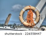 life buoy on a boat side.... | Shutterstock . vector #226558447