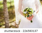 bride holding a wedding bouquet | Shutterstock . vector #226583137