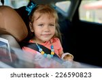 child in car in seat with belt... | Shutterstock . vector #226590823