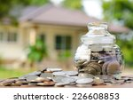 money coins with home  saving... | Shutterstock . vector #226608853