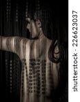 erotica nude woman back through ... | Shutterstock . vector #226623037
