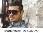 portrait of young man with...   Shutterstock . vector #226639297