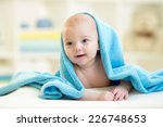 Baby Boy Under Blue Towel Afte...