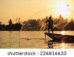 Fisherman Working At Sunrise.