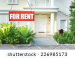 real estate sign in front of... | Shutterstock . vector #226985173