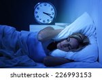 woman awake early in the... | Shutterstock . vector #226993153