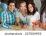 young friends having a drink... | Shutterstock . vector #227024953
