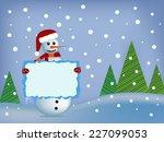 happy snowman holding a banner   Shutterstock . vector #227099053