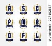Set of laurel foliate wheat wreaths and heraldry monogram design elements for creating classic heraldic logos