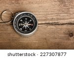 Compass On Wooden Background...