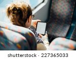 Woman Reading Book On The Trai...